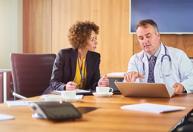lawyer consulting with medical expert witness